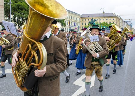 brass band: Munich, Germany -  September 20, 2015:  The Oktoberfest is the world biggest beer festival and at the opening parade with rd. 9000 participants take part in historical costumes, music bands and horses.