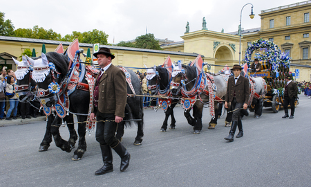 the coachman: Munich, Germany -  September 20, 2015:  The Oktoberfest is the world biggest beer festival and at the opening parade with rd. 9000 participants take part in historical costumes, music bands and horses.