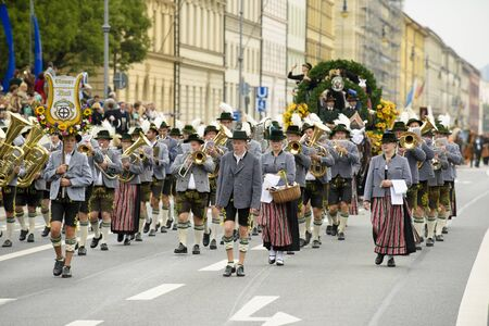 beer festival: Munich, Germany -  September 20, 2015: The Oktoberfest in Munich, Germany, is the biggest beer festival of th world. About 9000 people in historical costume groups, music bands, artists or riders with horses and carriages have participated at the public o Editorial