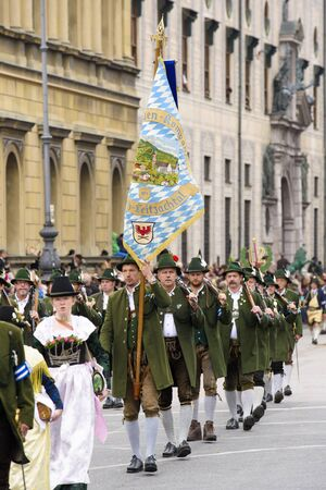 lederhose: Munich, Germany -  September 20, 2015:  The Oktoberfest in Munich, Germany, is the biggest beer festival of th world. About 9000 people in historical costume groups, music bands, artists or riders with horses and carriages have participated at the public