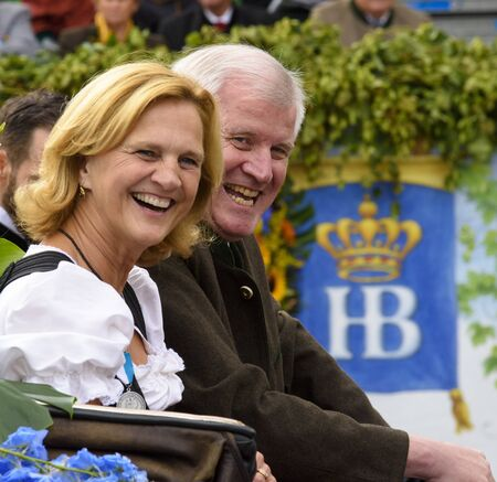 prime minister: Munich, Germany -  September 20, 2015:  Bavarian prime minister Horst Seehofer and his wife Karin were guests at the opening parade of the famous Oktoberfest, the biggest beer festival of the world Editorial
