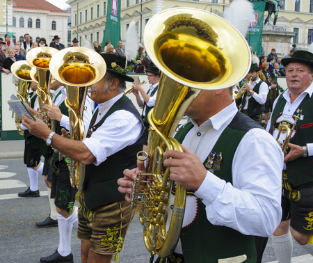 lederhose: Munich, Germany -  September 20, 2015:  The Oktoberfest is the world biggest beer festival and at the opening parade with rd. 9000 participants take part in historical costumes, music bands and horses.