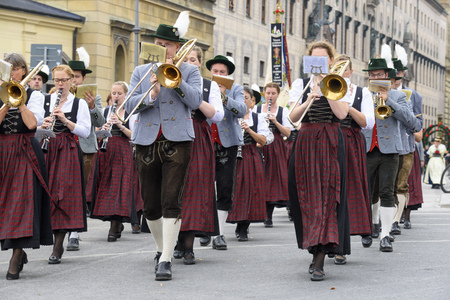 beer festival: Munich, Germany -  September 20, 2015: The Oktoberfest is the world biggest beer festival and at the opening parade with rd. 9000 participants take part with historical costumes, music bands and horses Editorial
