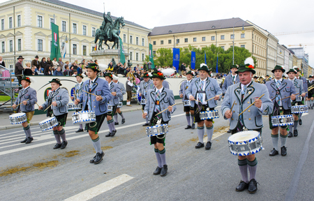 lederhose: Munich, Germany -  September 20, 2015: The Oktoberfest is the world biggest beer festival and at the opening parade with rd. 9000 participants take part with historical costumes, music bands and horses Editorial