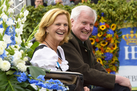 the prime minister: Munich, Germany -  September 20, 2015:  Bavarian prime minister Horst Seehofer and his wife Karin were guests at the opening parade of the famous Oktoberfest, the biggest beer festival of the world Editorial