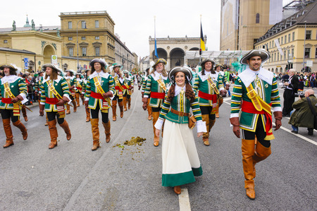 historical events: Munich, Germany -  September 20, 2015: The Oktoberfest is the world biggest beer festival and at the opening parade with rd. 9000 participants take part with historical costumes, music bands and horses Editorial