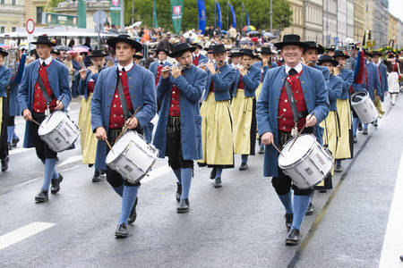 rd: Munich, Germany -  September 20, 2015:  The Oktoberfest is the world biggest beer festival and at the opening parade with rd. 9000 participants take part in historical costumes, music bands and horses.