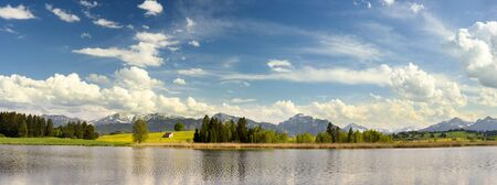 the surface of the water: panorama landscape with lake and alps mountains in Bavaria, Germany