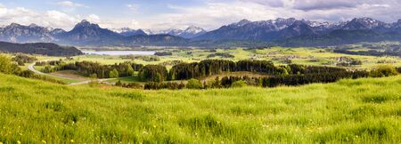 landscape nature: panorama landscape with lake and alps mountains in Bavaria, Germany