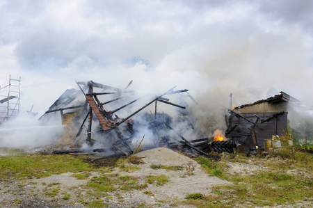 destroyed farm house by fire in Germnay Stock Photo