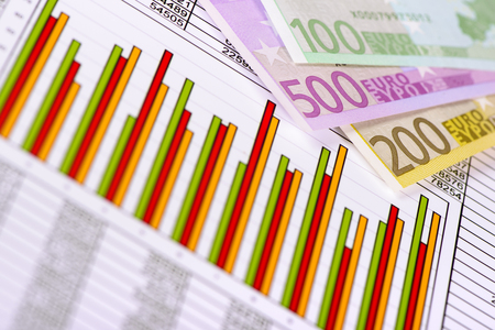 stock market: Euro banknotes and chart show success at finance and stock market Stock Photo
