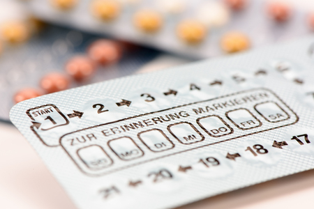 drug control: pills for birth control with german weekly calendar