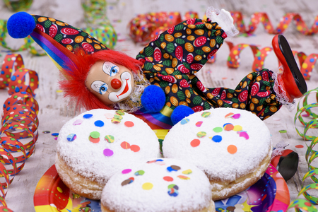 doughnut at carnival with confetti and clown
