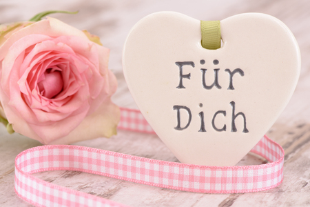 translated: Valentines day with heart and inscription in german language, translated in english: for you