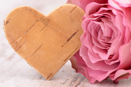 Valentines day in romance with rose and heart as symbol for love