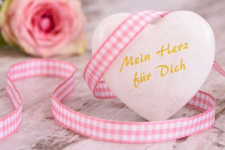 translated: Valentines day with heart and inscription in german language, translated in english: my heart for you