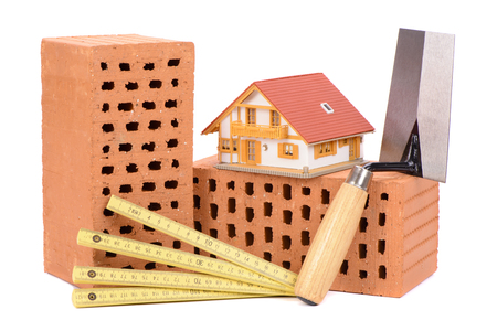 model house: brick for house construction and tool with model house