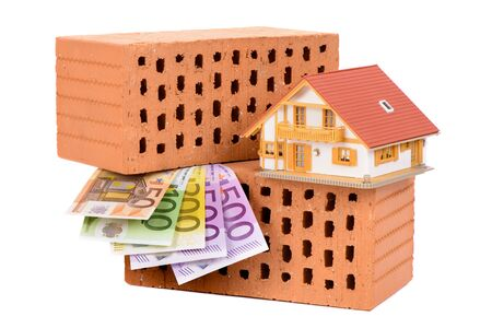 brick walls: brick for house construction and Euro money with model house Stock Photo
