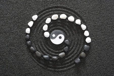 raked: Japanese ZEN garden with yin and yang stone in raked sand