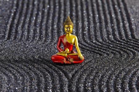 raked: Japanese ZEN garden with Buddha in raked sand Stock Photo