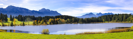 Panorama landscape in Bavaria with beautiful lake and alps mountains
