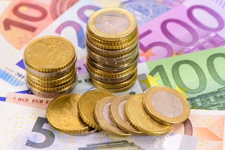 currencies: Euro currency and banknotes Stock Photo