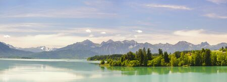 panorama landscape in Bavaria with lake and mountains