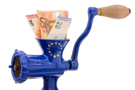 financial symbol: Euro banknotes while destruction in mincer as symbol for inflation or financial mismanagement