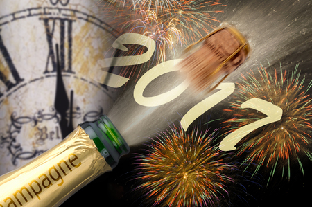 new year's day: popping champagne and fireworks at new years eve 2017