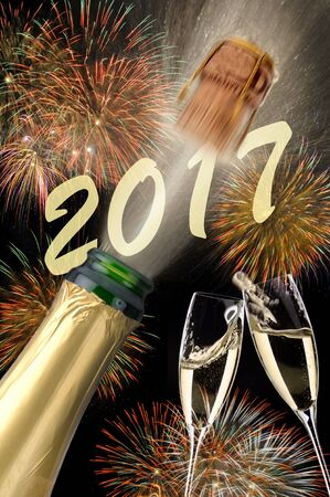 exploding: popping champagne and fireworks at new years eve 2017