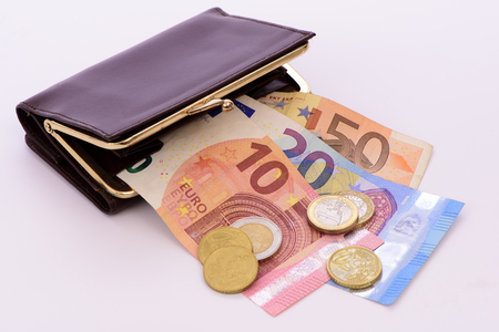Euro banknotes and coins laying in purse