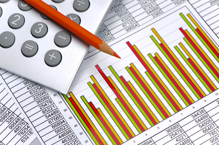 finance and calculation at stock market with chart and spreadsheet