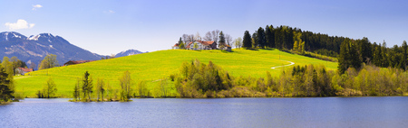 panorama landscape in Bavaria with lake and alps mountains Stock Photo