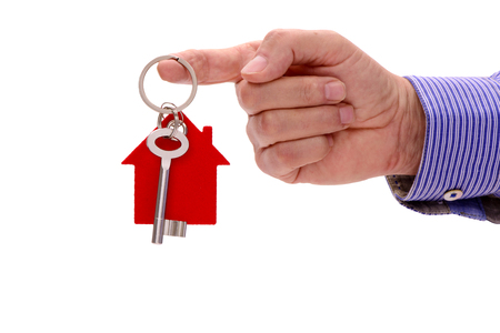 house key in hand of real estate agent Stock Photo