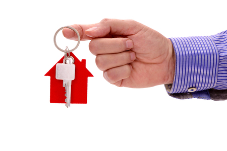 apartment for rent: house key in hand of real estate agent Stock Photo