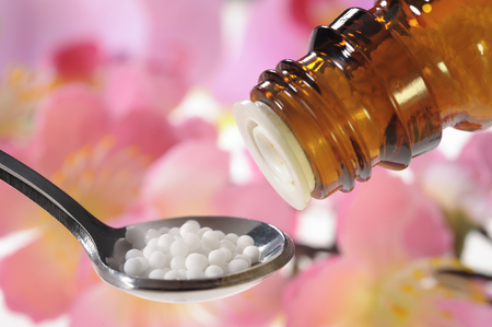 granule: homeopathic globules as therapy for alternative medicine Stock Photo