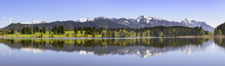 beautiful panorama landscape with alps mountains mirroring in lake