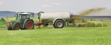 fertilization with liquid manure in Bavaria, Germany Stock Photo