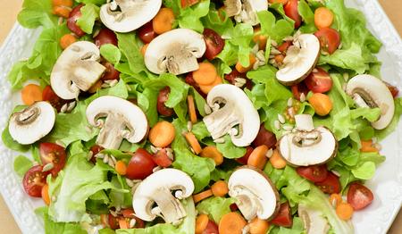 fresh green salad with mushrooms Фото со стока