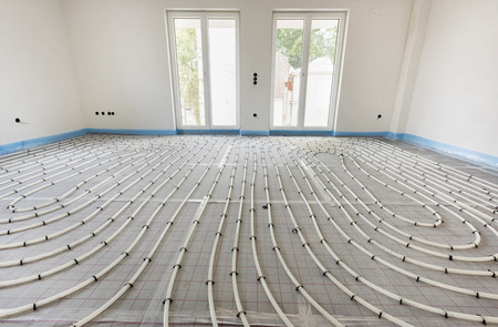 underfloor heating in construction of new residential house Stok Fotoğraf - 84549773