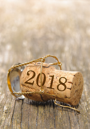 cork of champagne with new years date 2018