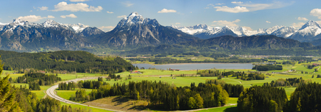 wide angle panorama landscape in Bavaria with lake and alps mountains