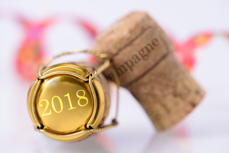 uncork: cork of champagne with new years date 2018