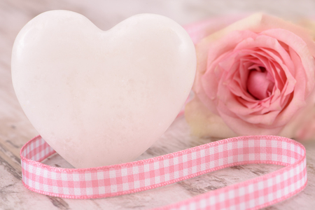 rose flower with heart as symbol for love Stock Photo