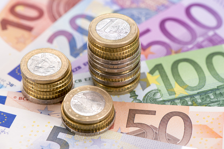 Euro currency with banknotes and stacked coins