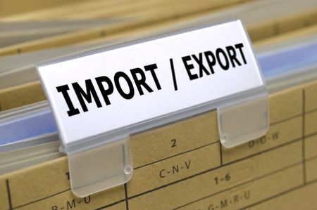 import - export printed on top of file folder with documents inside