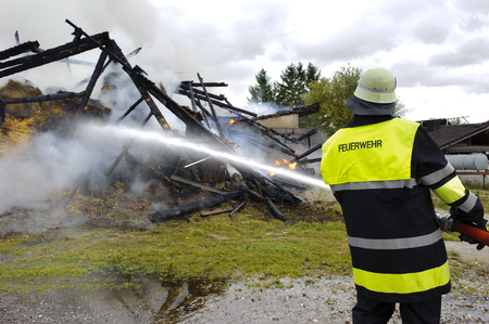 fire brigade in action at burning farm house in Bavaria, Germany,