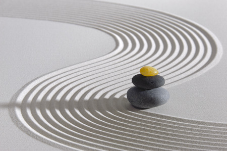 Japanese Zen garden of tranquility with stone in textured sand