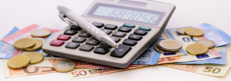 many banknotes of European currency with calculator and coins