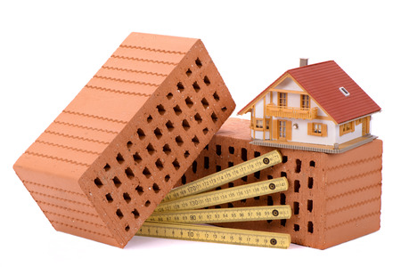 house construction with brick, tools, plan and model house Stock fotó